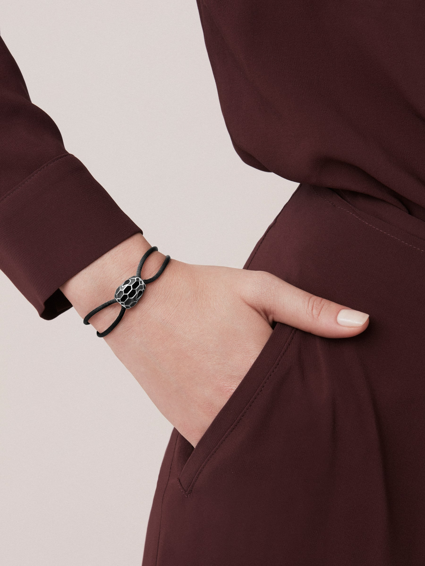 """Serpenti Forever"" bracelet in fire amber silk with an iconic snakehead décor in fire amber and black enamel with seducing eyes in black enamel. SERP-STRINGa image 2"