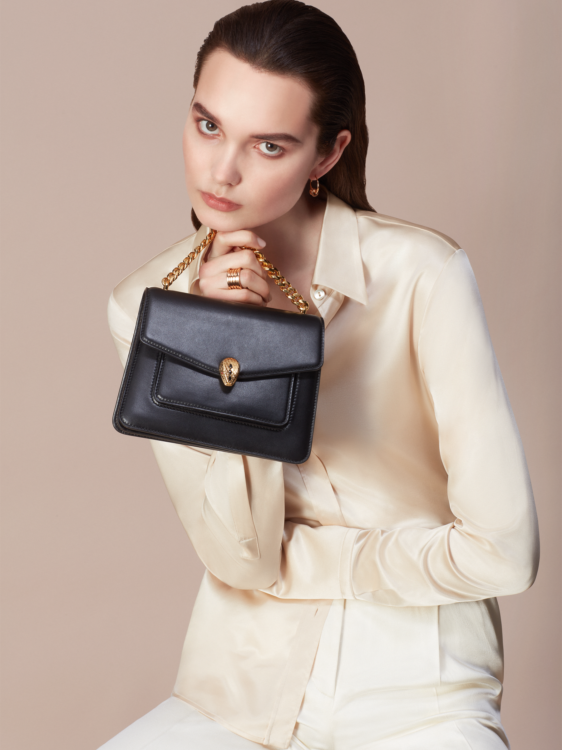 """""""Serpenti Forever"""" small maxi chain crossbody bag in black nappa leather, with black nappa leather inner lining. New Serpenti head closure in gold-plated brass, finished with small black onyx scales in the middle, and red enamel eyes. 291050 image 8"""
