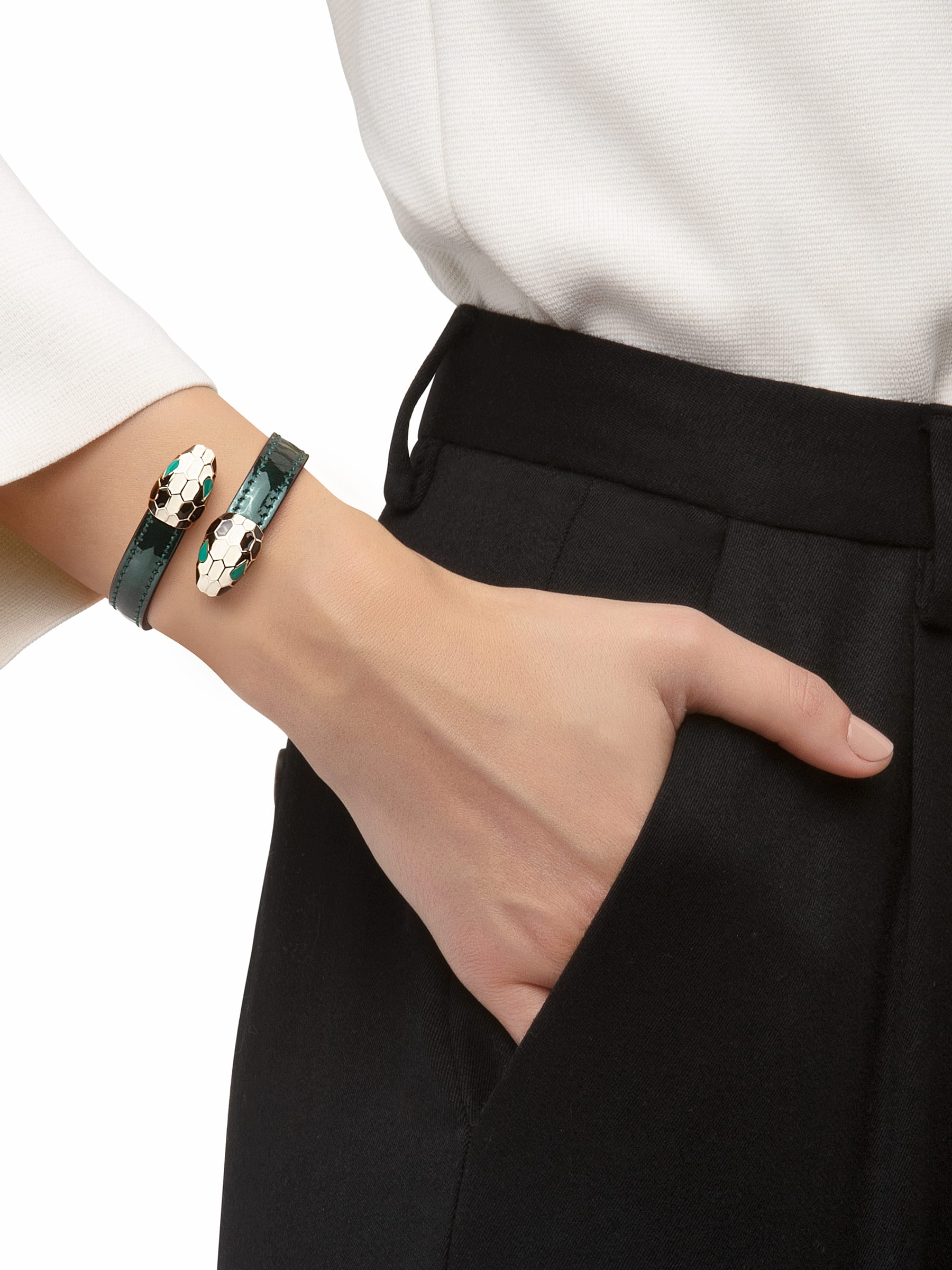 Serpenti Forever soft bangle bracelet in shiny silver brushed metallic calf leather, with brass light gold plated hardware. Iconic contraire snakehead décor in black and white enamel, with green enamel eyes. SerpSoftContr-BMCL-FE image 2