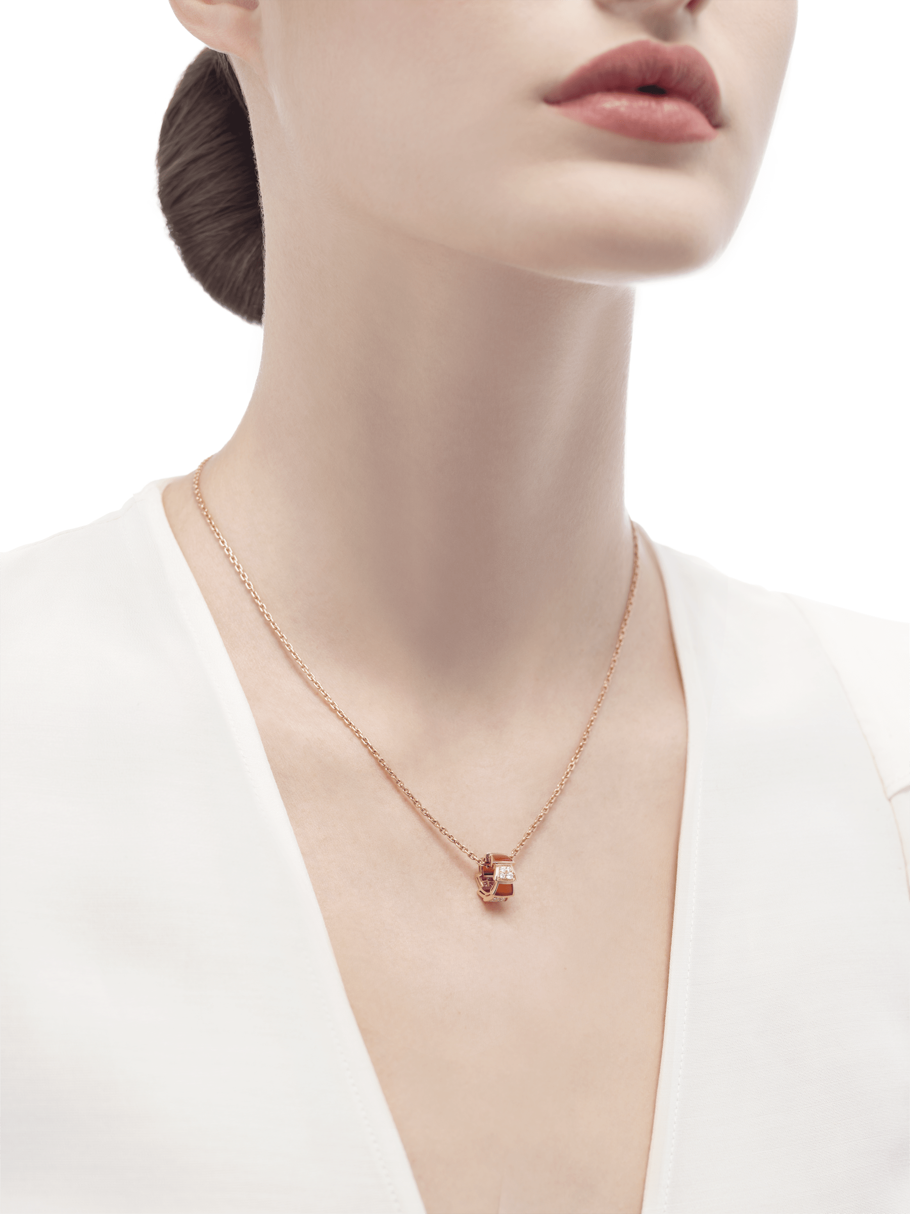 Serpenti Viper necklace with 18 kt rose gold chain and 18 kt rose gold pendant set with carnelian elements and demi-pavé diamonds. 355088 image 4