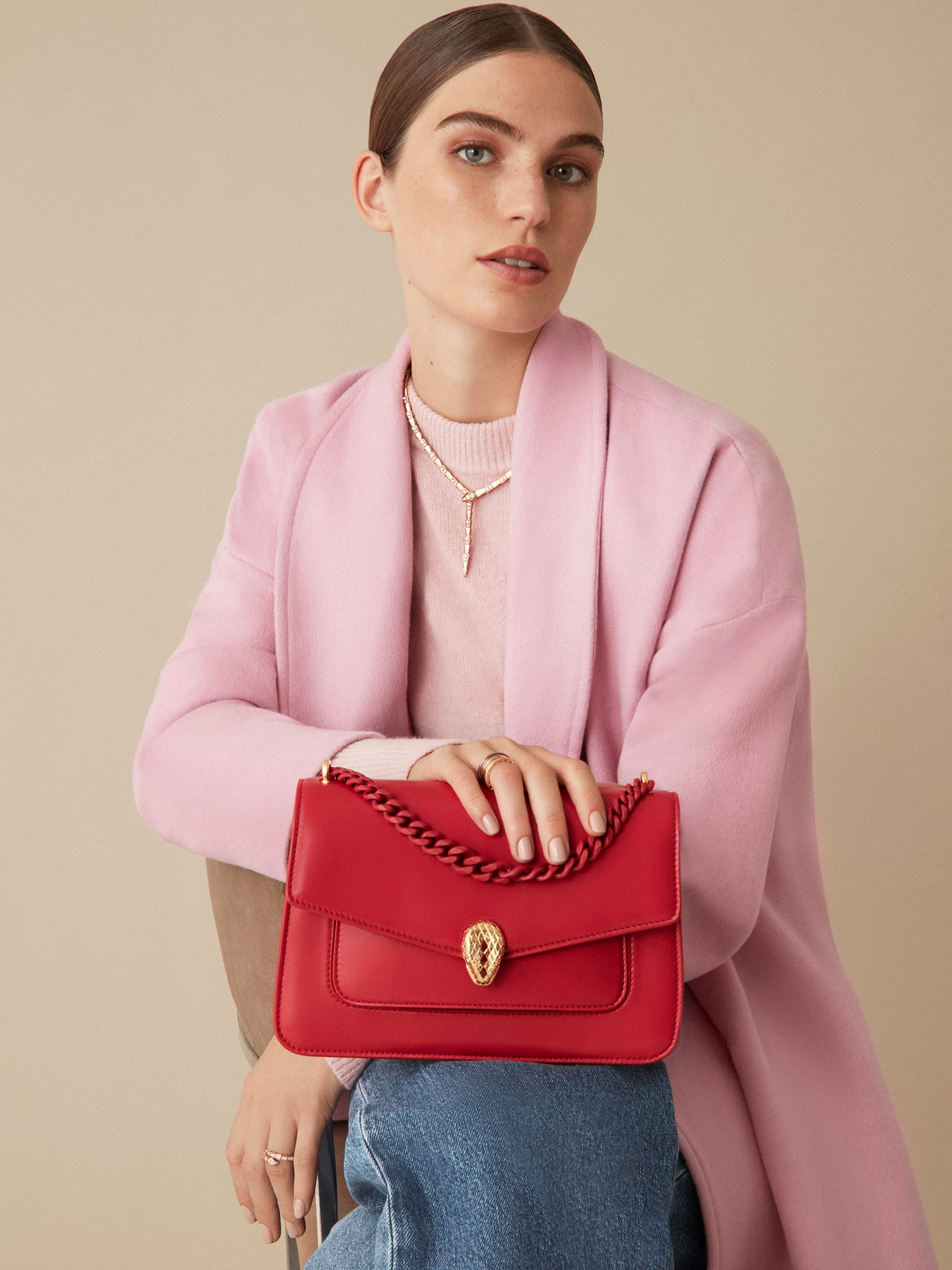 """Serpenti Forever"" maxi chain crossbody bag in Amaranth Garnet red nappa leather, with Pink Spinel fuchsia nappa leather inner lining. New Serpenti head closure in gold-plated brass, finished with small red carnelian scales in the middle and red enamel eyes. 1138-MCN image 8"