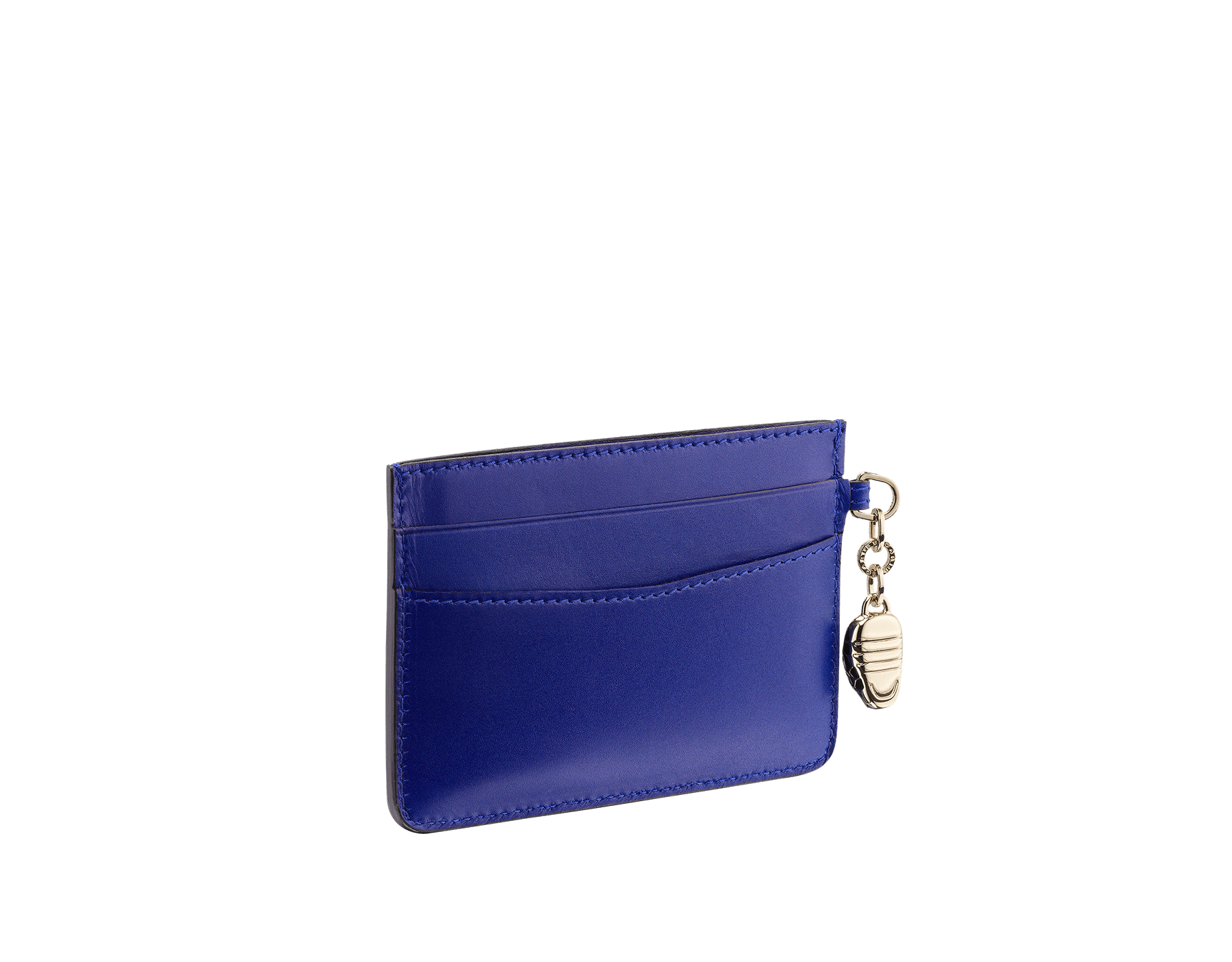 Credit card holder in royal sapphire and teal topaz calf leather. Serpenti charm in black and white enamel with green malachite enamel eyes and Bulgari logo in metal characters. Four credit card slots and one compartment. Also available in other colours. 10,5 x 7,5 cm. - 4.1. x 3.0'' 282021 image 1