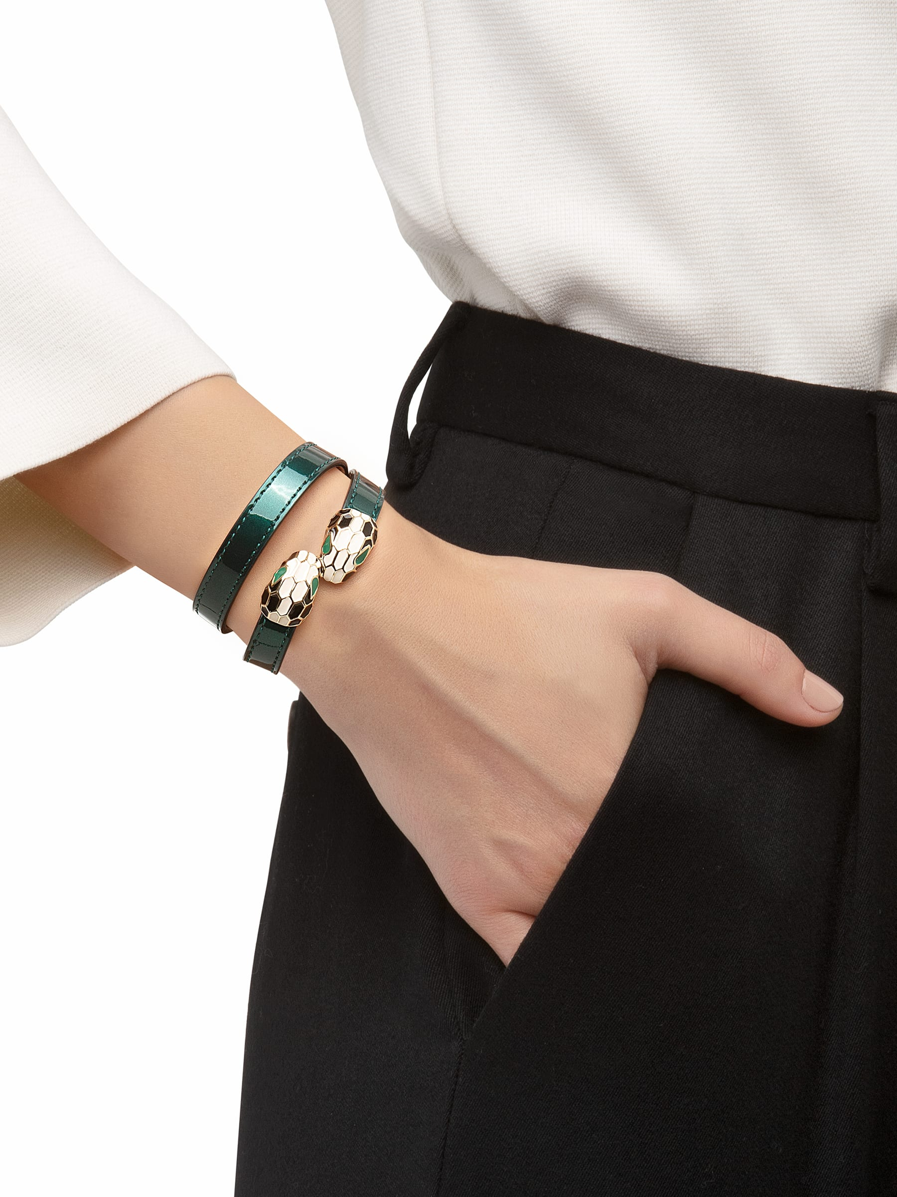 Multi-coiled bracelet in forest emerald brushed metallic calf leather. Brass light gold plated iconic contraire Serpenti heads in black and white enamel with green enamel eyes. MCSerp-BMCL-FE image 2