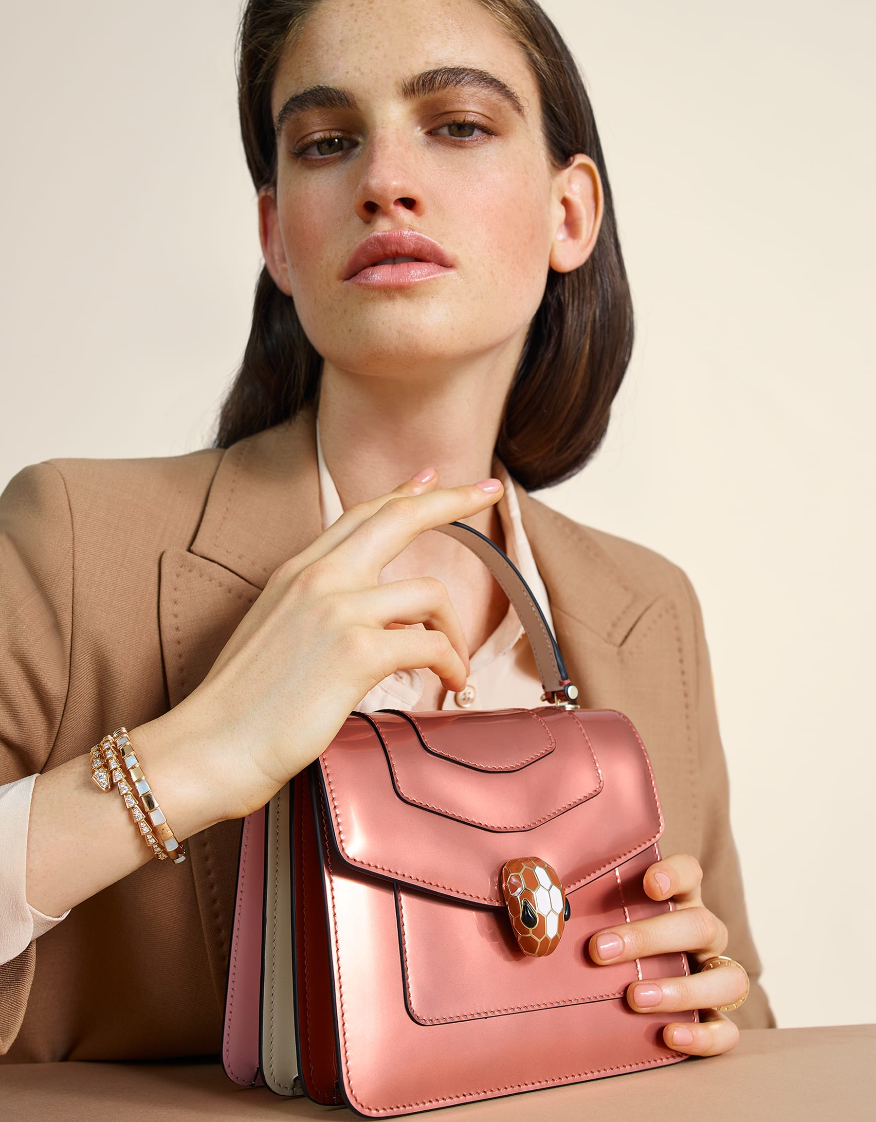 Serpenti Forever crossbody bag in imperial topaz brushed metallic calf leather with Roman garnet, rosa di francia and white agate calf leather sides. Iconic snakehead closure in light gold plated brass embellished with imperial topaz and white enamel and black onyx eyes. 752-NBMCL image 6