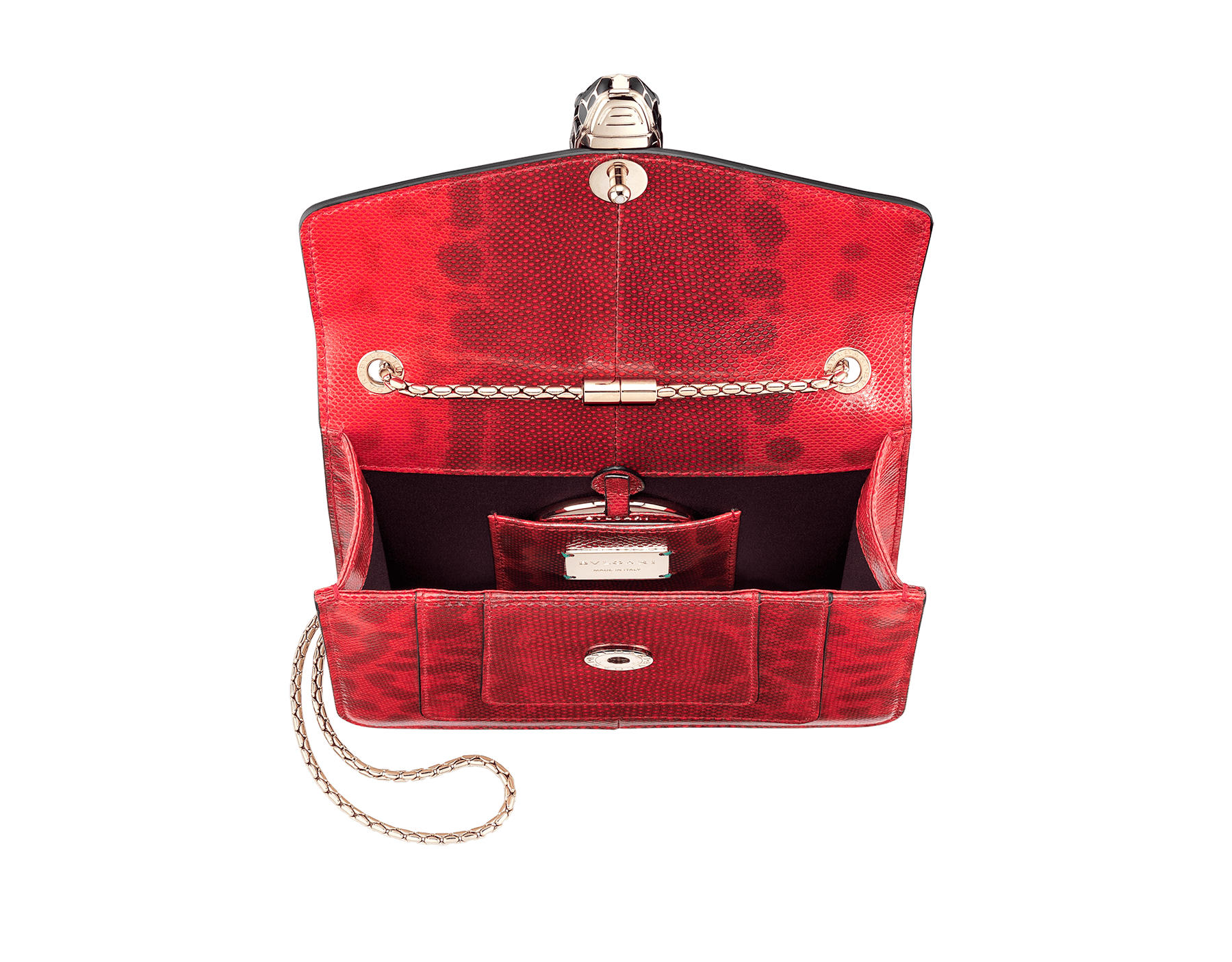 Serpenti Forever crossbody bag in sea star coral shiny karung skin. Snakehead closure in light gold plated brass decorated with black and white enamel, and green malachite eyes. 287911 image 4