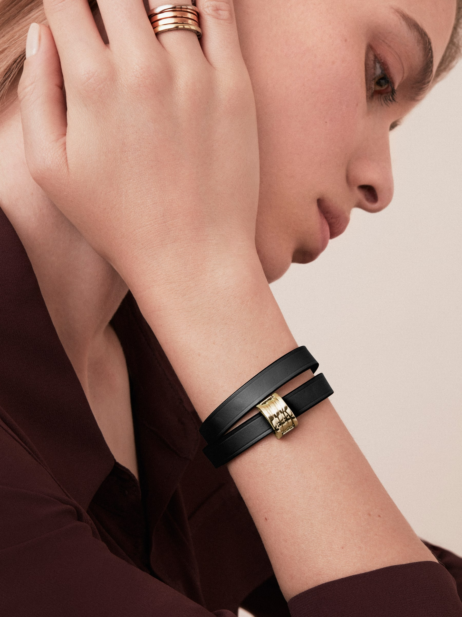 """""""Bvlgari Bvlgari"""" double-coiled bracelet in black calf leather, with B.Zero1 snap closure in light gold plated brass. BZERO1-CL-B image 2"""