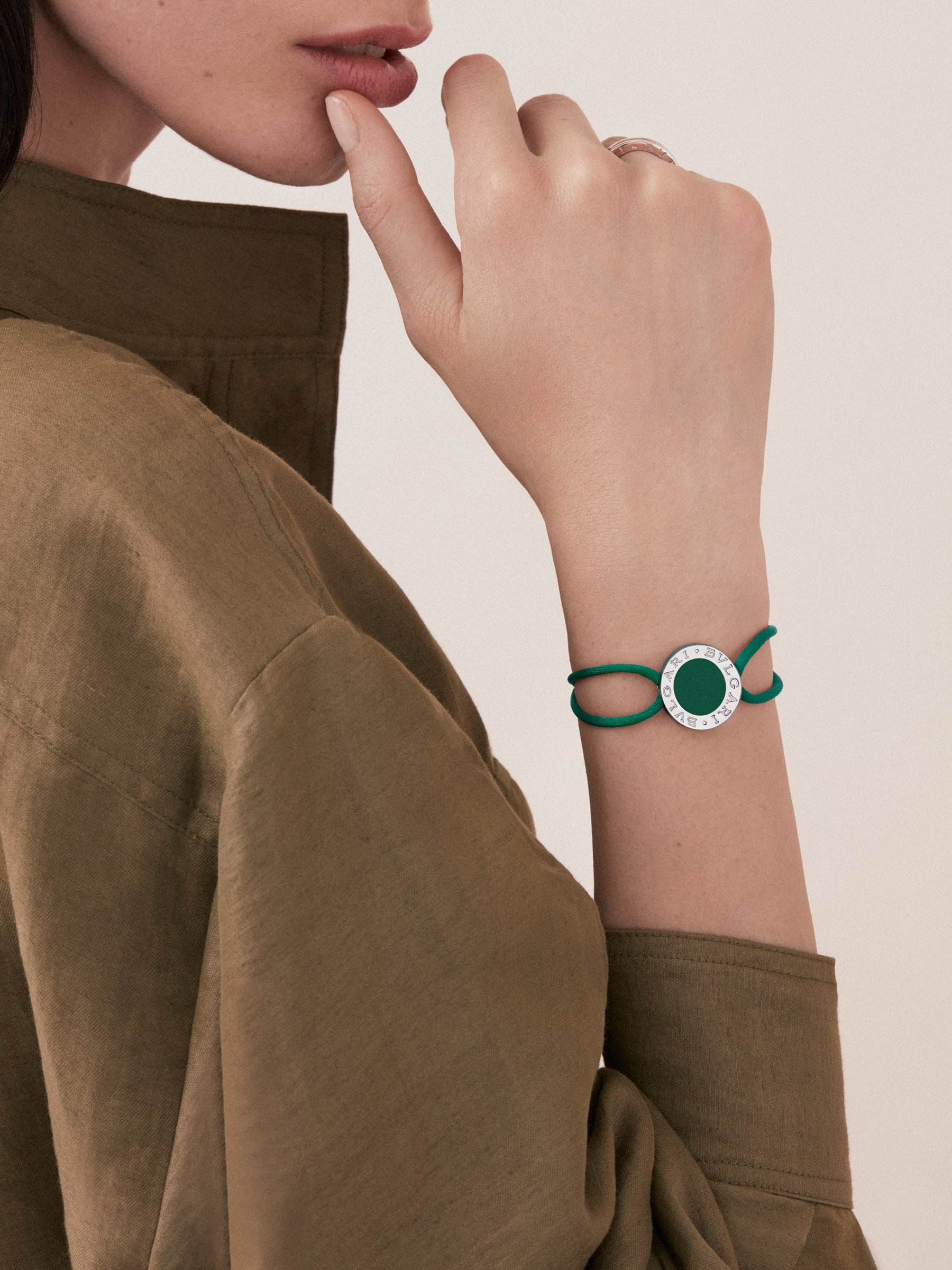 """BVLGARI BVLGARI"" bracelet in emerald green fabric with an iconic logo décor in sterling silver and black enamel. BRACLT-LUCKYUb image 2"