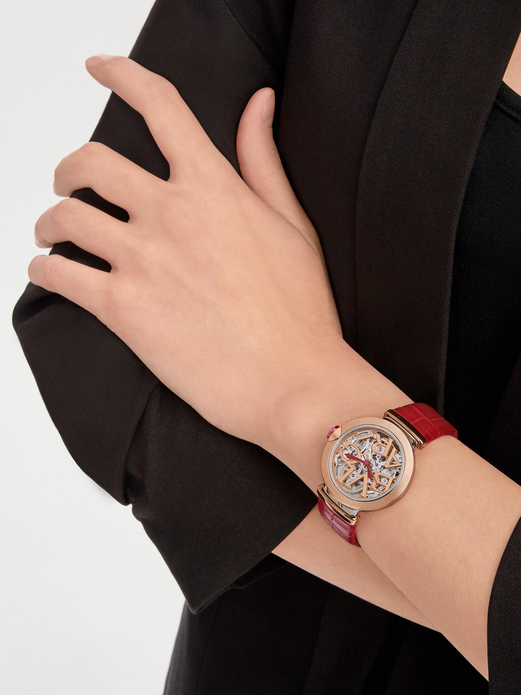 LVCEA Skeleton 腕錶,搭載機械機芯,自動上鍊,鏤空設計,拋光精鋼錶殼,18K 玫瑰金錶圈、鏤空 BVLGARI 標誌錶盤和連結扣,紅色鱷魚皮錶帶。防水深度 30 公尺。 103373 image 1