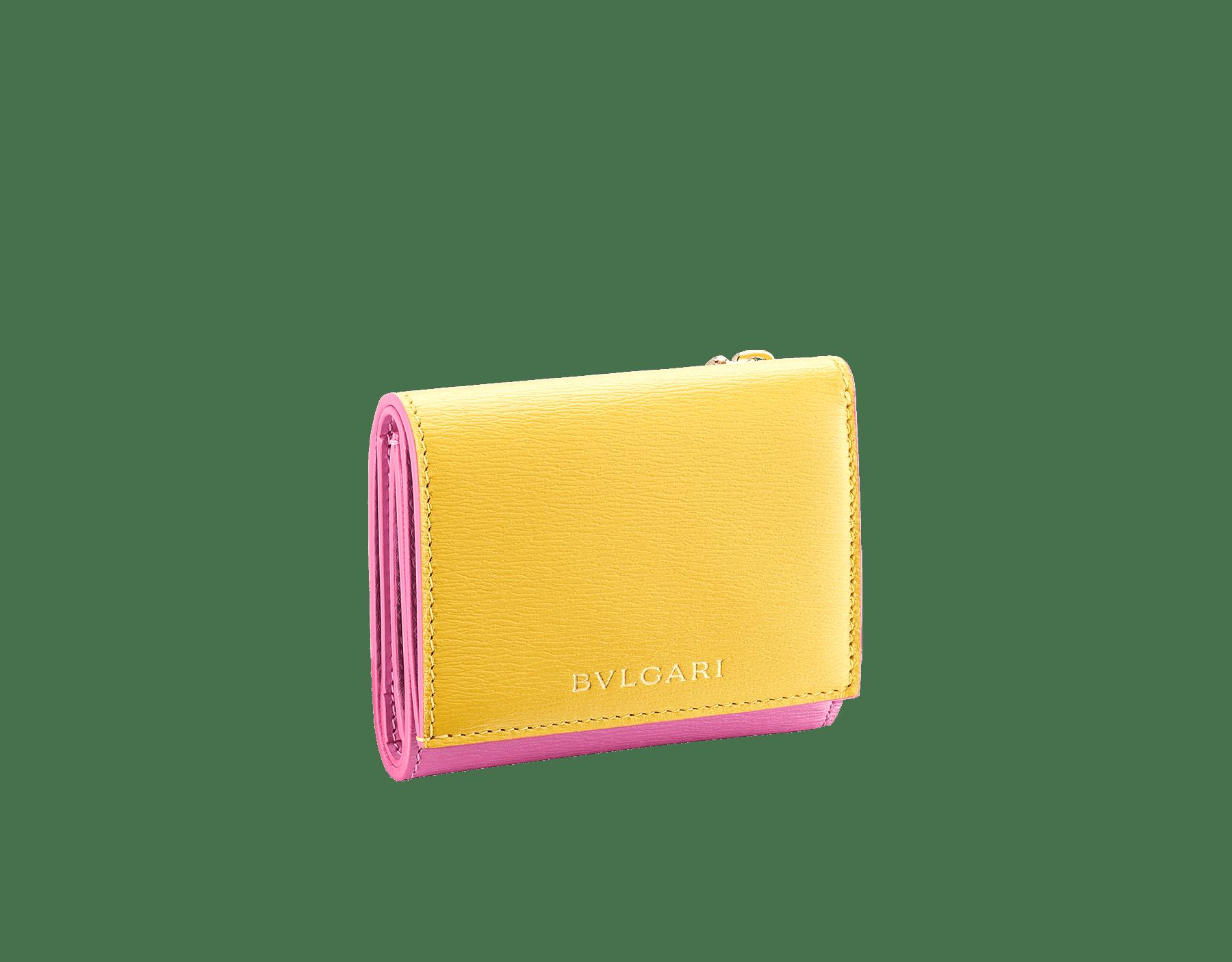B.zero1 compact wallet in daisy topaz, taffy quartz goatskin and taffy quartz nappa leather. Iconic B.zero1 zipper in light gold plated brass and two press stud closures. BZA-SLIMCOMPACT image 1
