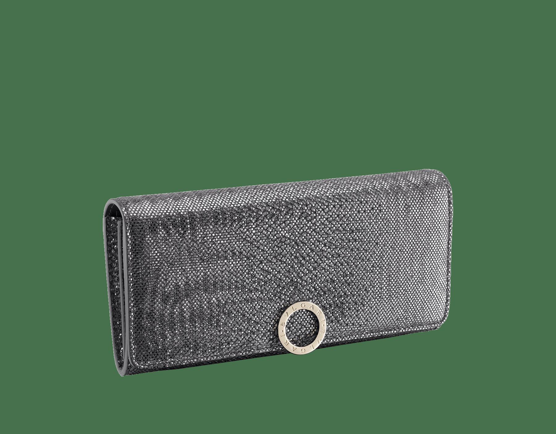 Wallet pochette in emerald green shiny karung skin and amethyst purple nappa. Brass light gold plated hardware and iconic BVLGARI BVLGARI closure clip. 579-WLT-SLI-POC-CL-MK image 1
