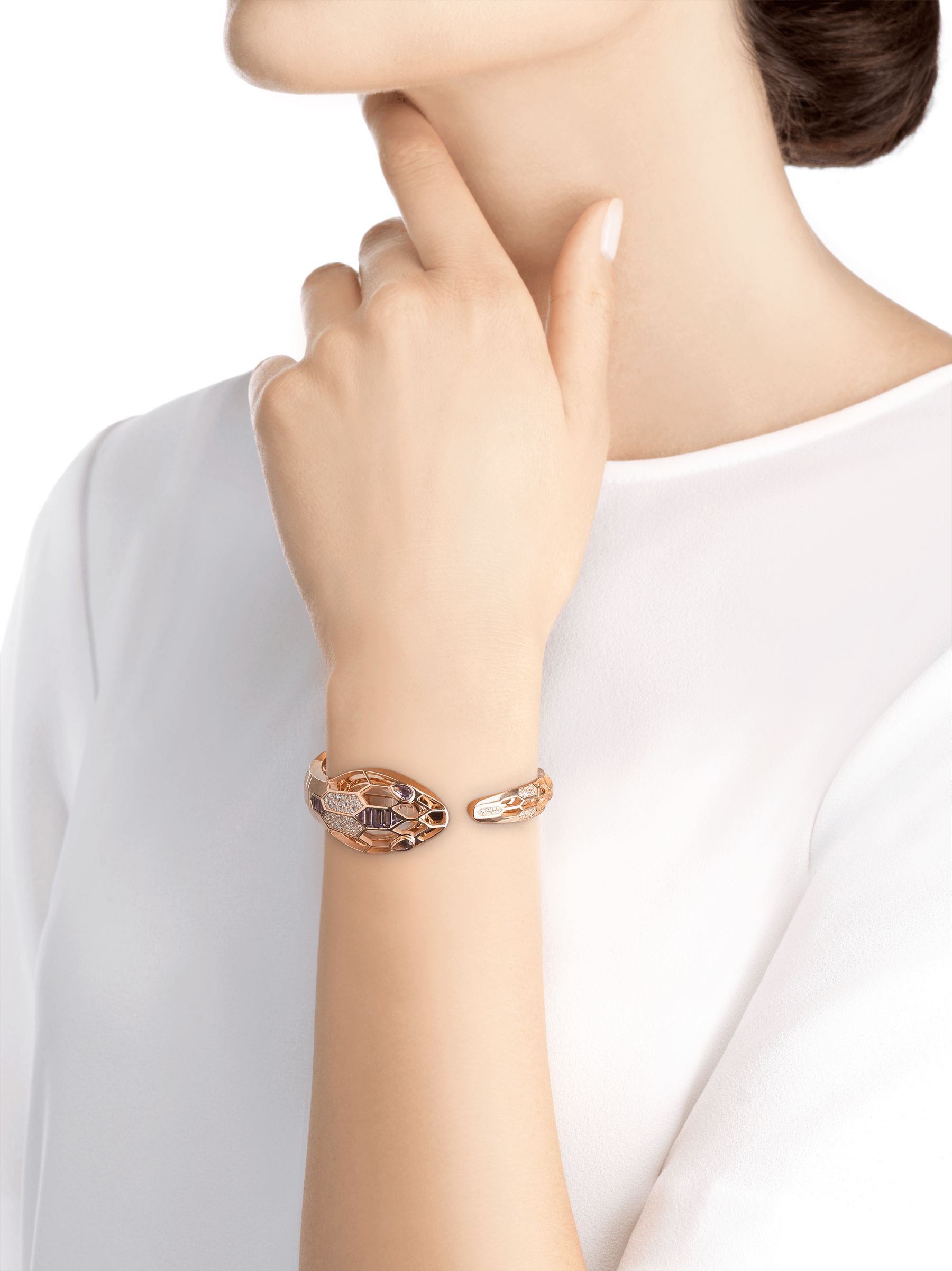 Serpenti Misteriosi Secret Watch in 18 kt rose gold case and bracelet both set with round brilliant-cut diamonds and baguette-cut amethysts, mother-of-pearl dial and pear shaped amethyst eyes. Medium size 103056 image 4