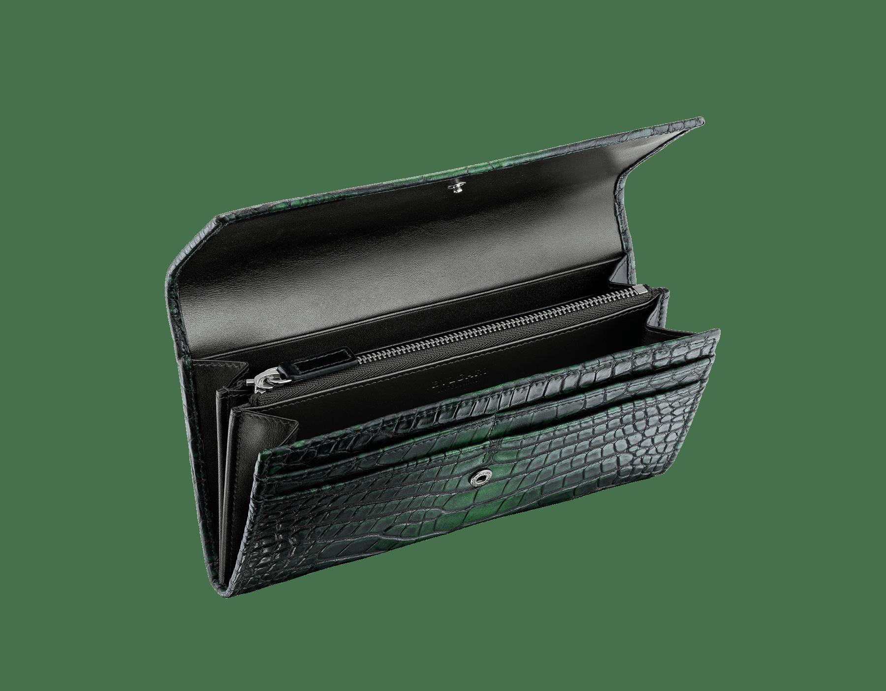 Man wallet pochette in Jungle green alligator skin and black smooth calf leather, with brass dark ruthenium plated hardware featuring the Bulgari-Bulgari motif. BBM-WLT-POC-10C-HE image 2