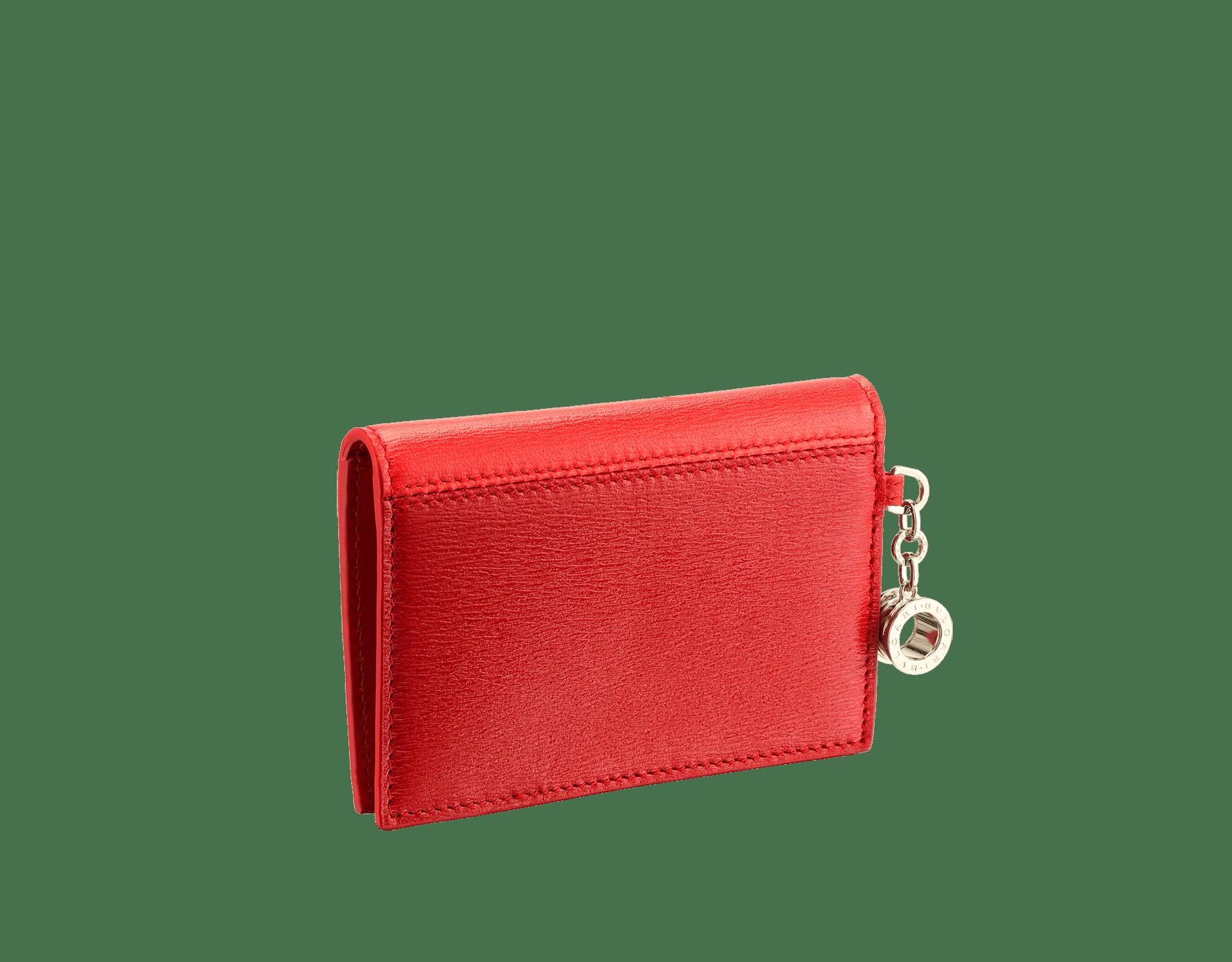 B.zero1 open credit card holder in sea star coral and carmine jasper goatskin. Iconic B.zero1 charm in light gold-plated brass. 288237 image 3