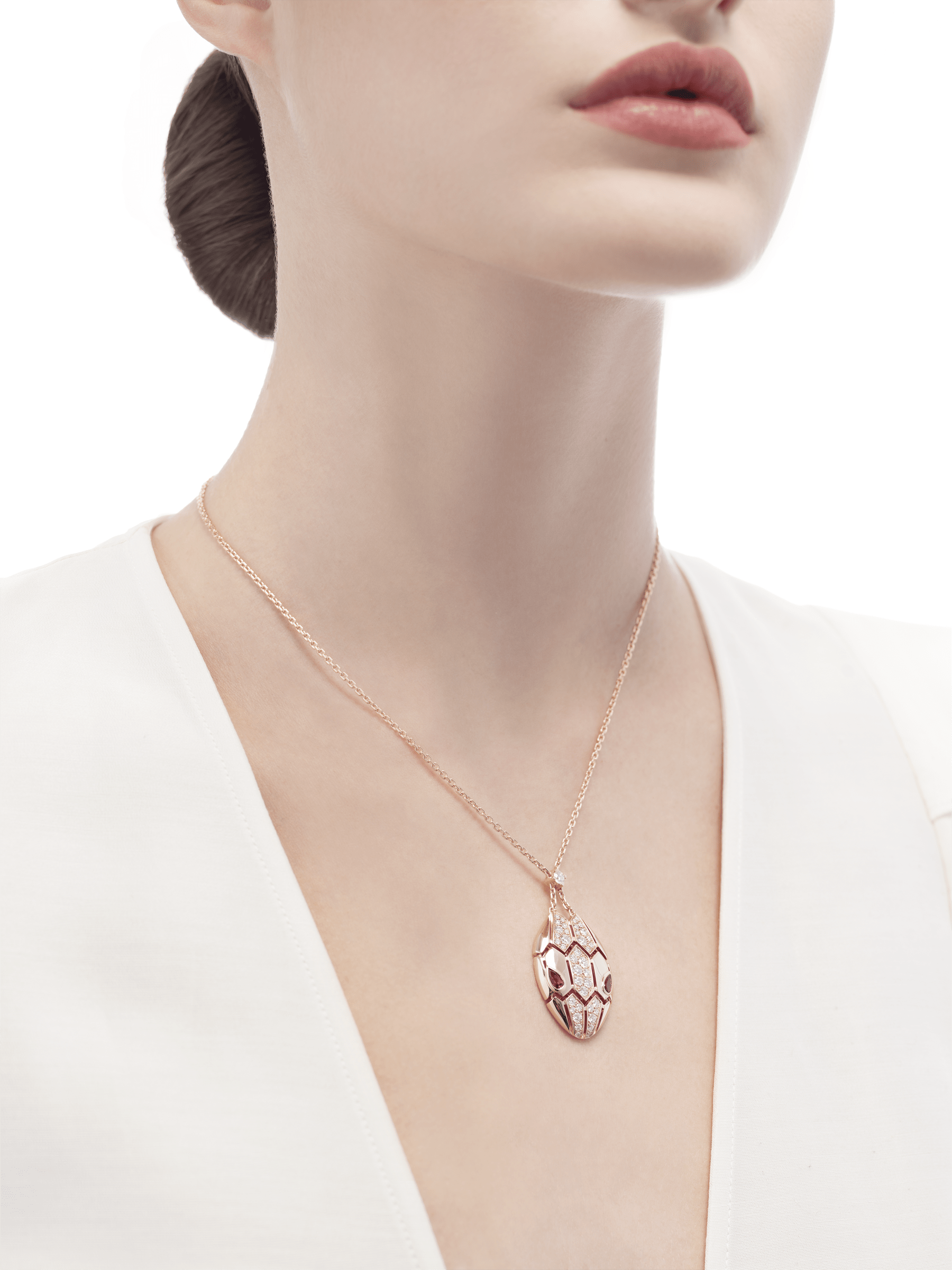 Serpenti necklace with 18 kt rose gold chain and pendant, set with rubellite eyes and demi pavé diamonds. 352748 image 4