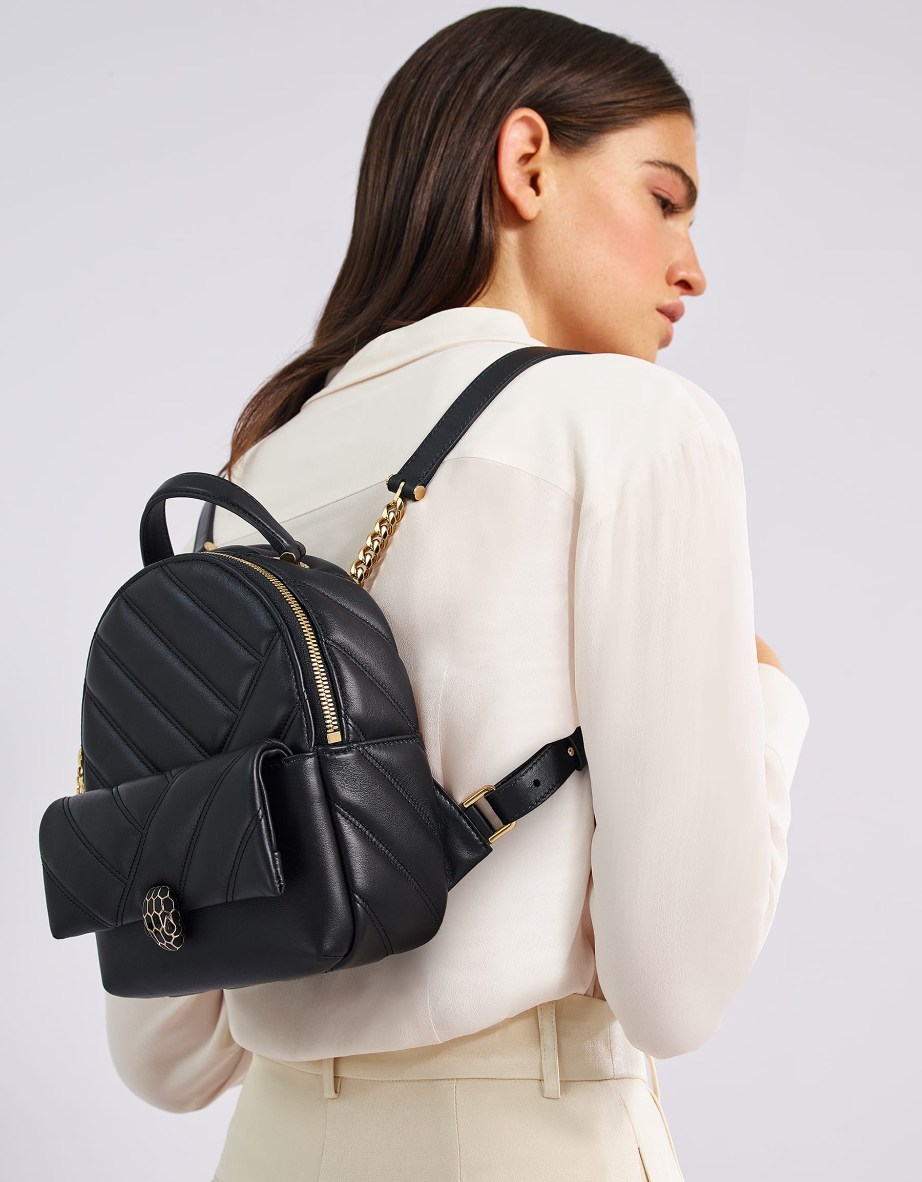 Serpenti Cabochon backpack in soft quilted black calf leather, with a graphic motif. Rose gold plated brass tempting snakehead closure in matte and shiny black enamel and black onyx eyes. 288735 image 5