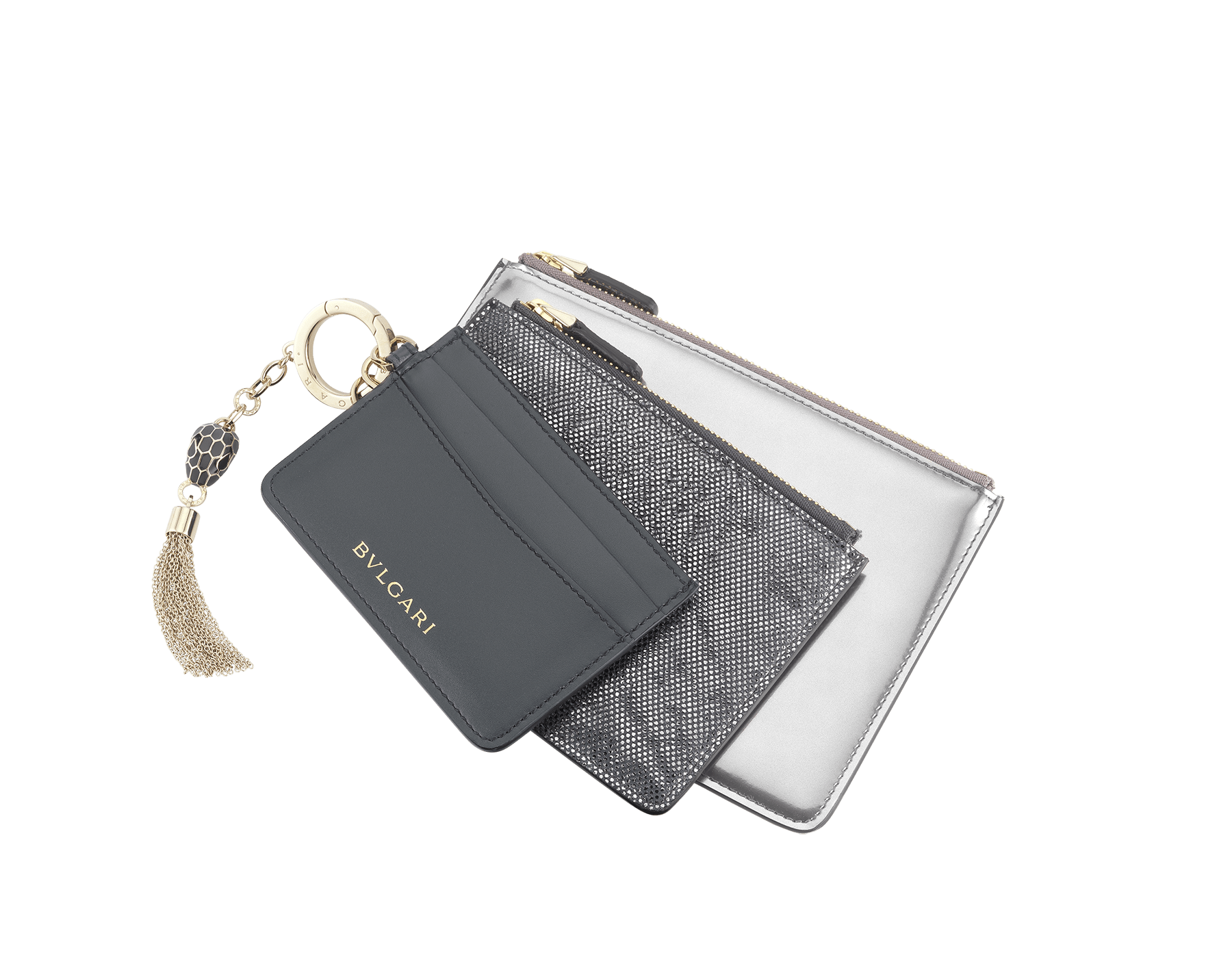 Serpenti Forever Trio in charcoal diamond calf leather, silver brushed metallic calf leather and charcoal diamond metallic karung skin. Brass light gold plated keyring with Serpenti head charm in black and charcoal diamond enamel, with black enamel eyes. 288469 image 1