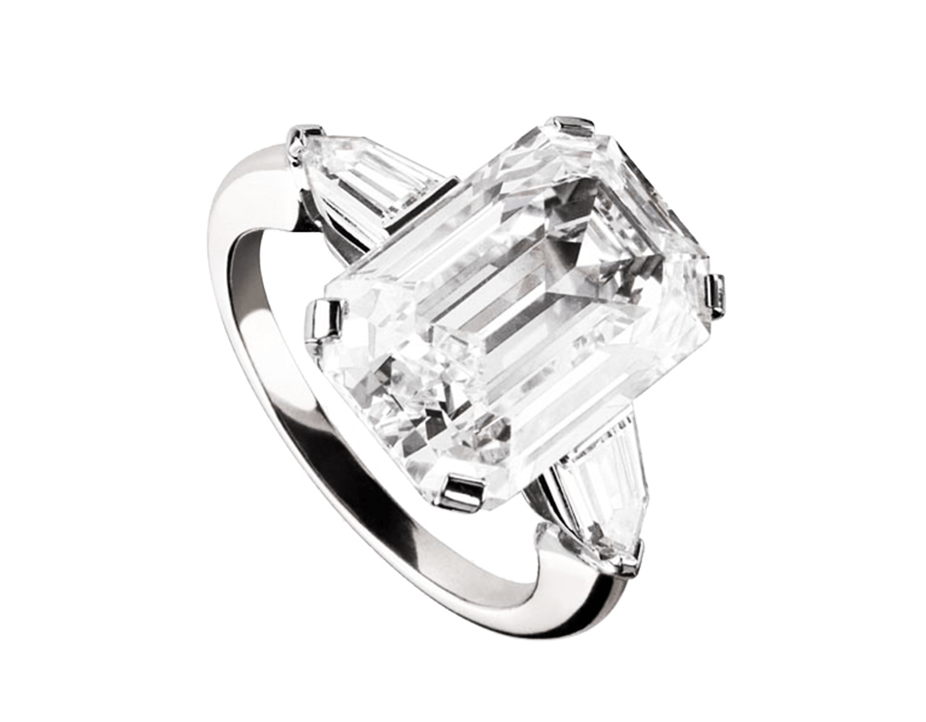 Griffe solitaire ring in platinum with emerald cut diamond and two side diamonds. Available from 1 ct. A classic setting that allows the beauty and the pureness of the solitaire diamond to assert itself 331824 image 1