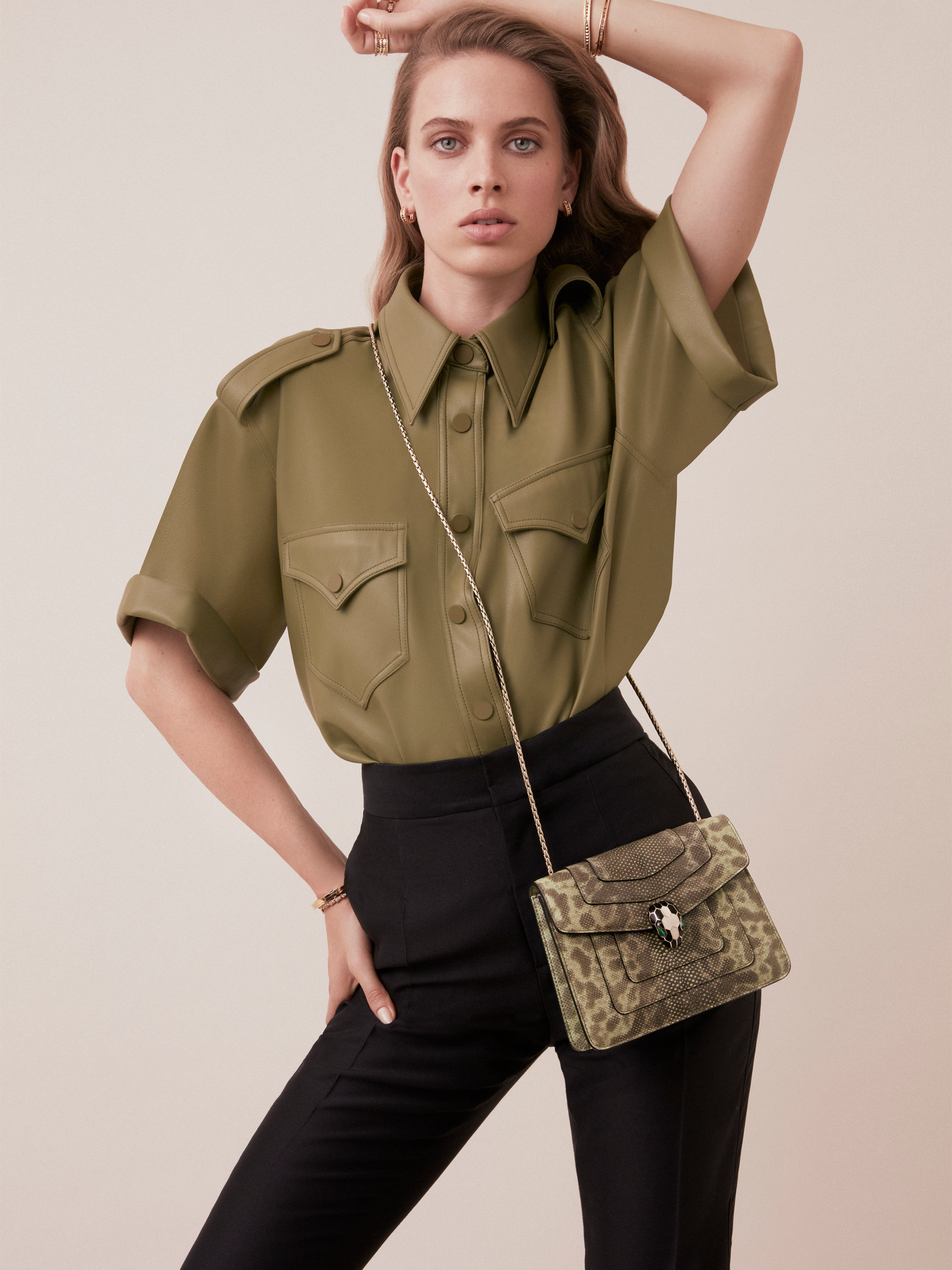 """Serpenti Forever"" crossbody bag in mint shiny karung skin. Iconic snakehead closure in light gold plated brass enriched with black and white enamel, and green malachite eyes. 422-SK image 2"