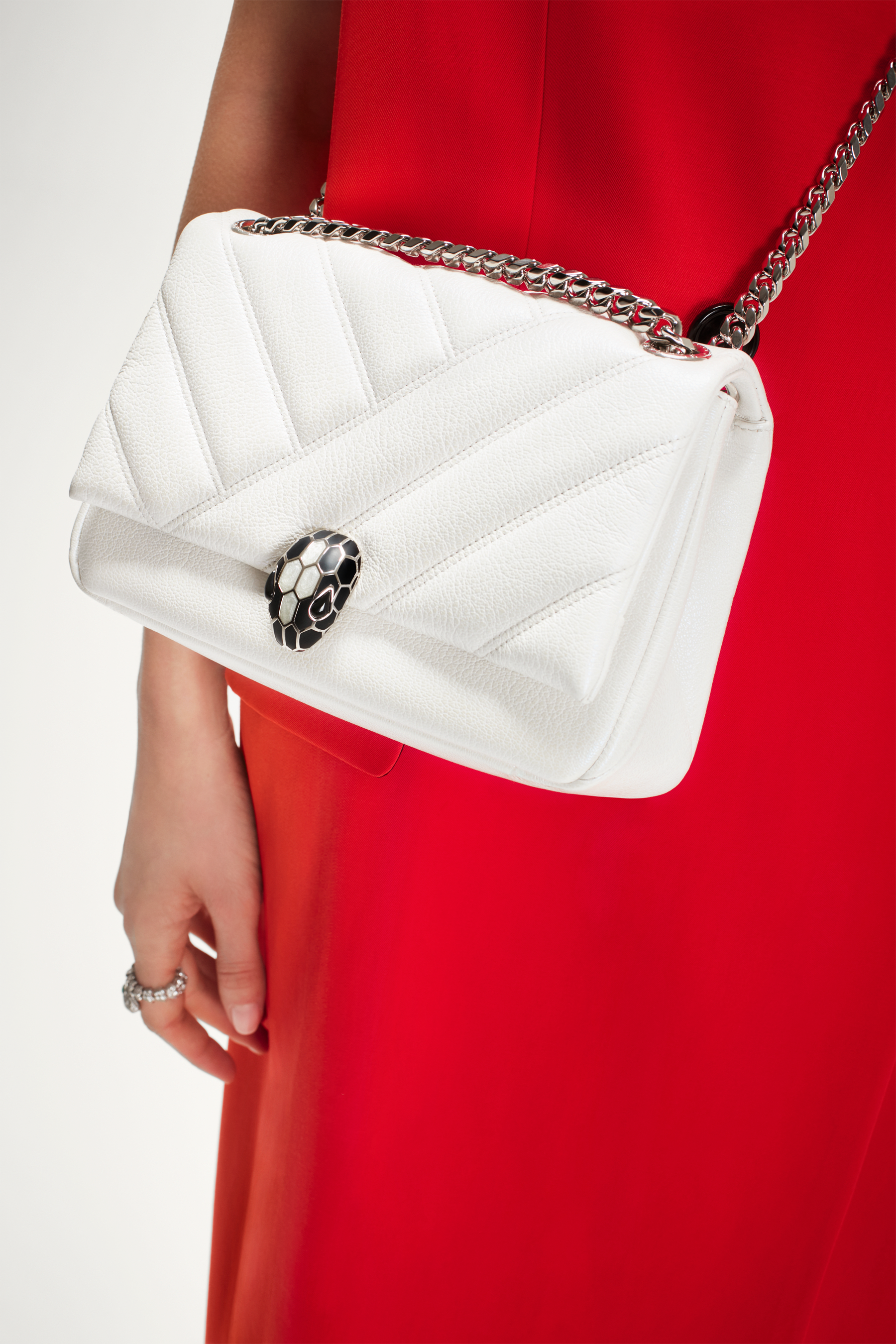 """Serpenti Cabochon"" shoulder bag in soft quilted white agate goatskin with a pearled, iridescent effect and a graphic motif. Brass palladium plated tempting snake head closure in matte black and shiny white enamel and black onyx eyes. 290236 image 6"