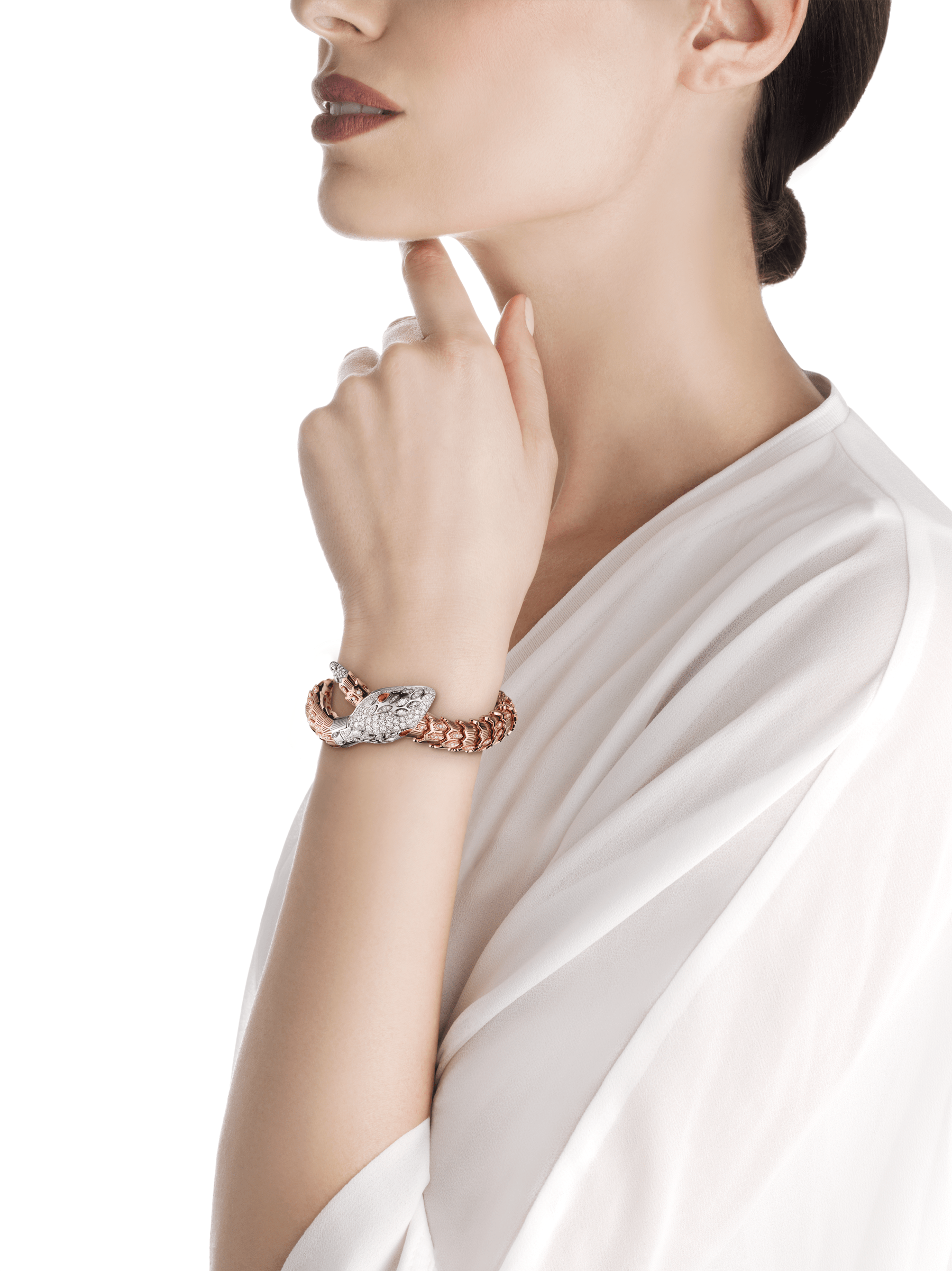 Serpenti Secret Watch with 18 kt white gold head set with brilliant cut and marquise cut diamonds and ruby eyes, 18 kt white gold case, 18 kt white gold dial set with brilliant cut diamonds, single spiral bracelet in 18 kt rose and white gold, set with brilliant cut diamonds. 102239 image 4