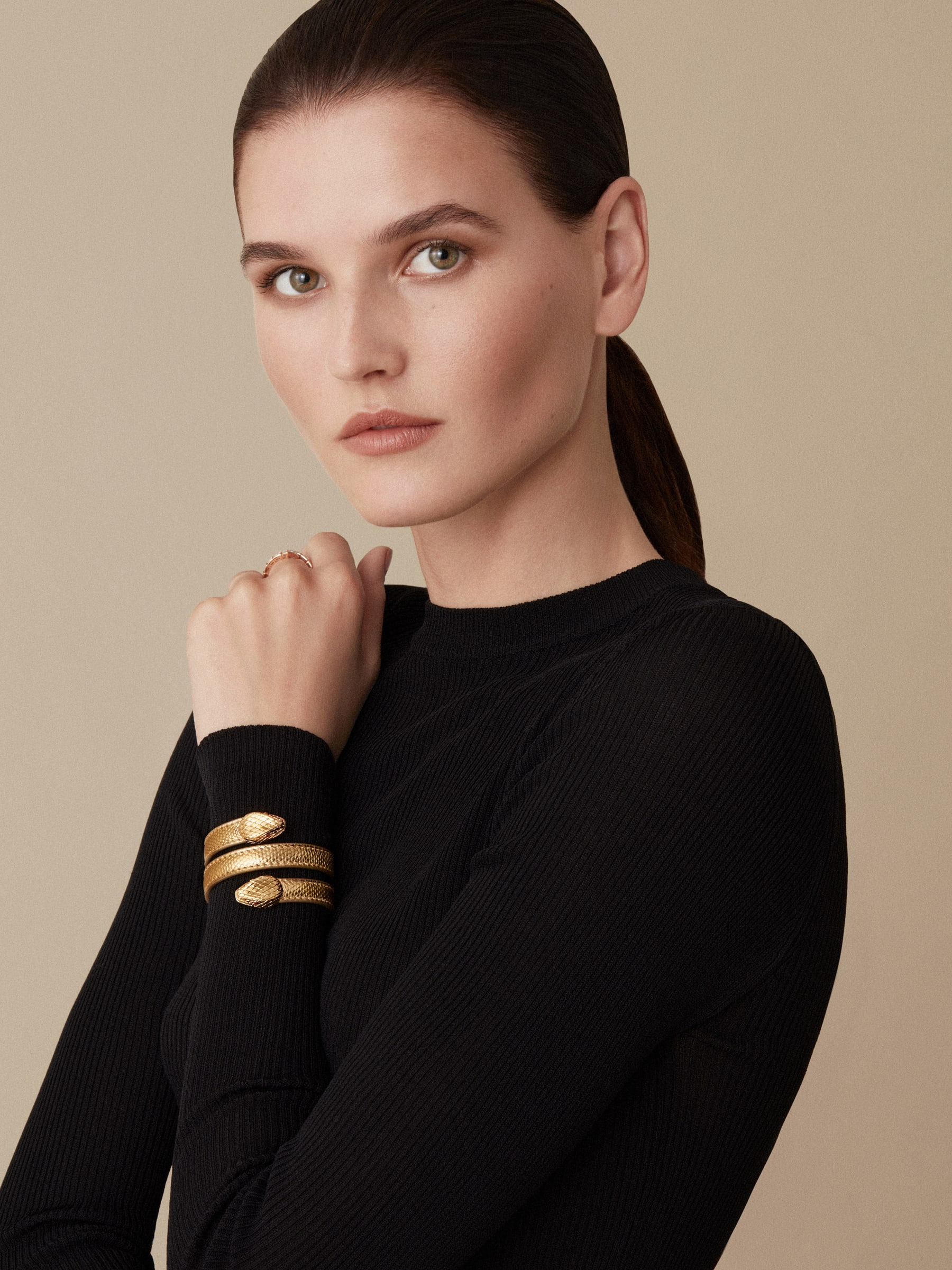 """Serpenti Forever"" multi-coil Cleopatra bangle in ""Molten"" gold karung skin, offering a touch of radiance for the Winter Holidays. New double Serpenti head in gold-plated brass, complete with ruby-red enamel eyes. Cleopatra-MK-G image 2"