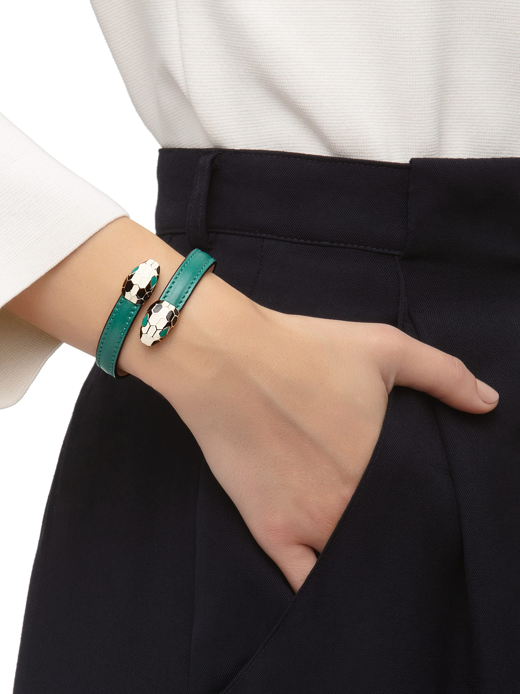 Serpenti Forever soft bangle bracelet in emerald green calf leather, with brass light gold plated hardware. Iconic contraire snakehead décor in black and white enamel, with green enamel eyes. SerpSoftContr-CL-EG image 2