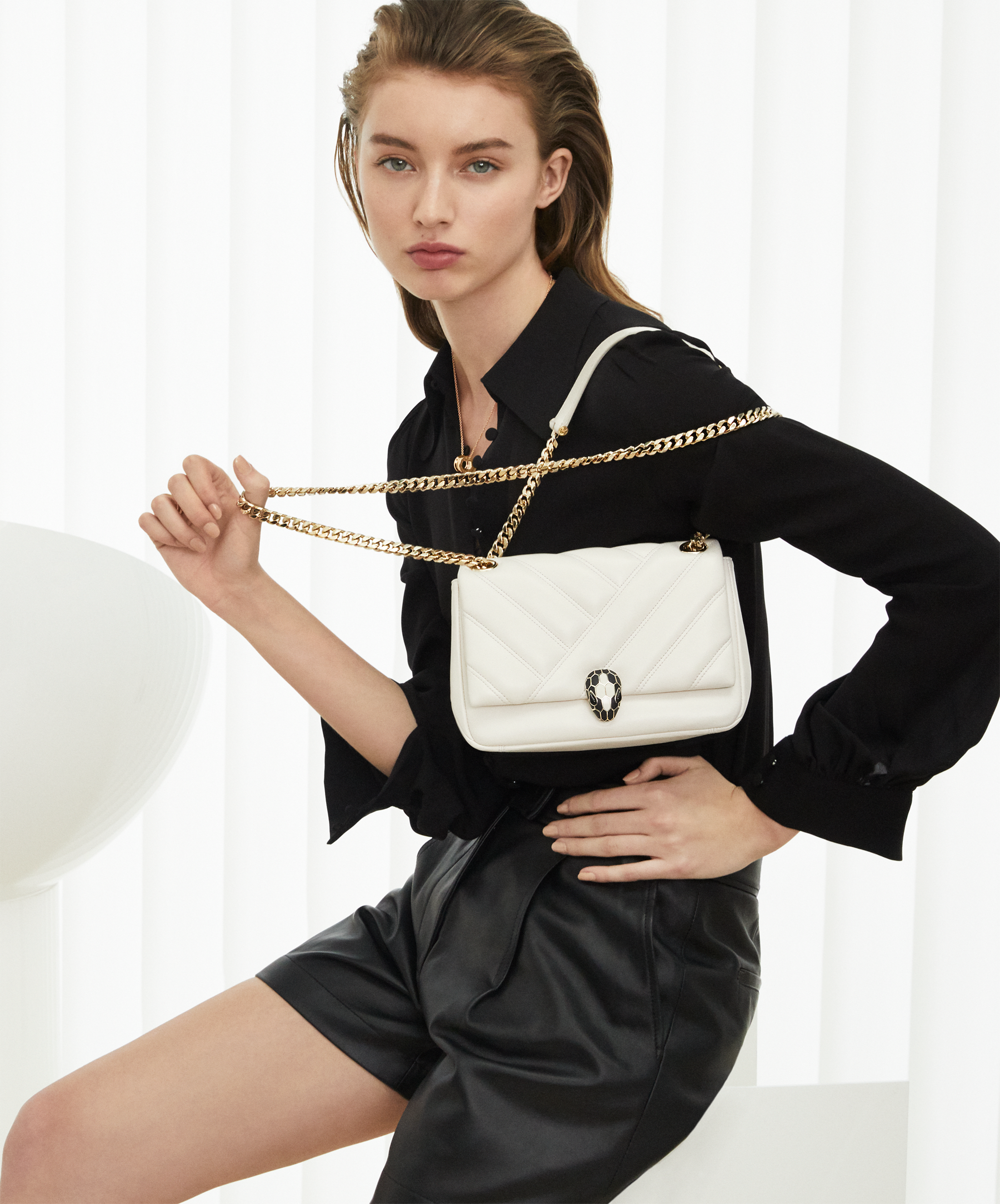 Serpenti Cabochon shoulder bag in soft matelassé white agate nappa leather with graphic motif and white agate calf leather. Snakehead closure in rose gold plated brass decorated with matte black and white enamel, and black onyx eyes. 287993 image 5