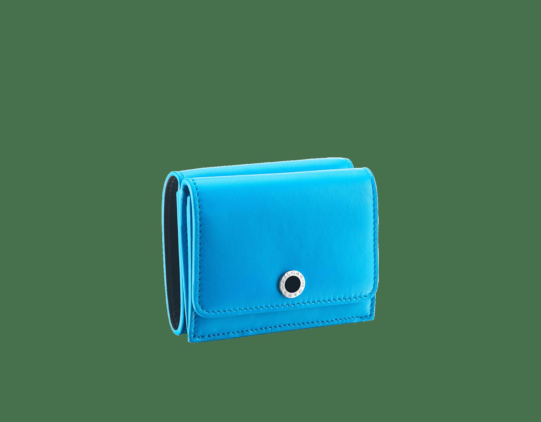 """Ambush x Bvlgari"" mini compact wallet in bright blue nappa leather. Palladium plated brass ""BVLGARI AMBUSH"" décor enameled in black on one side and special ""BVLGARI AMBUSH"" logo print on the other. Limited edition. YA-MINICOMPACT image 1"