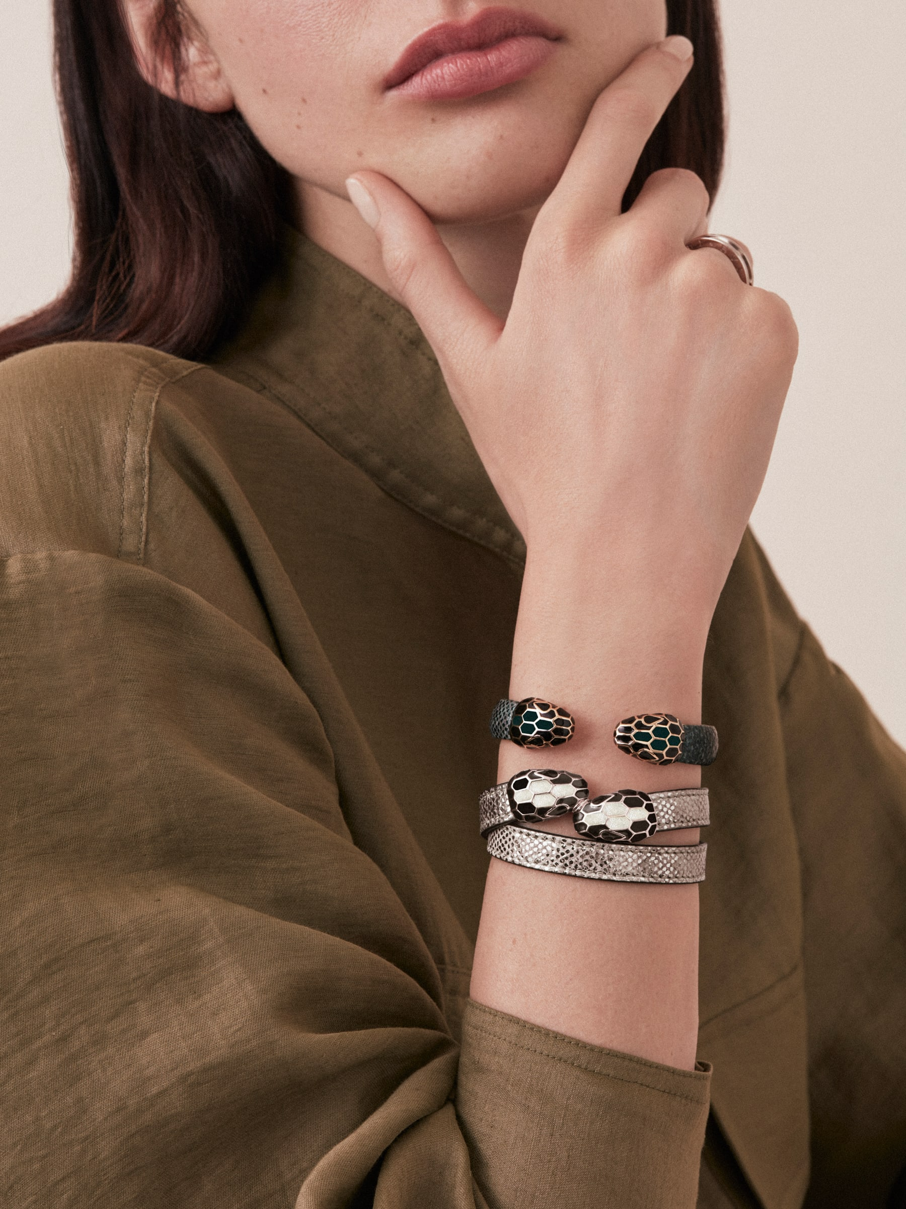 Serpenti Forever multi-coiled bracelet in milky opal metallic karung skin, with brass light gold plated hardware. Iconic contraire snakehead décor in black and glitter milky opal enamel, with black enamel eyes. MCSerp-MK-MO image 2