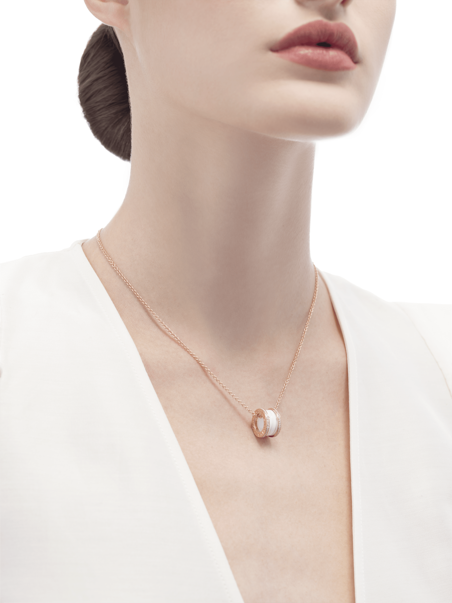 B.zero1 necklace with 18 kt rose gold chain and round pendant with two 18 kt rose gold loops set with pavé diamonds on the edges and a white ceramic spiral. 350053 image 4