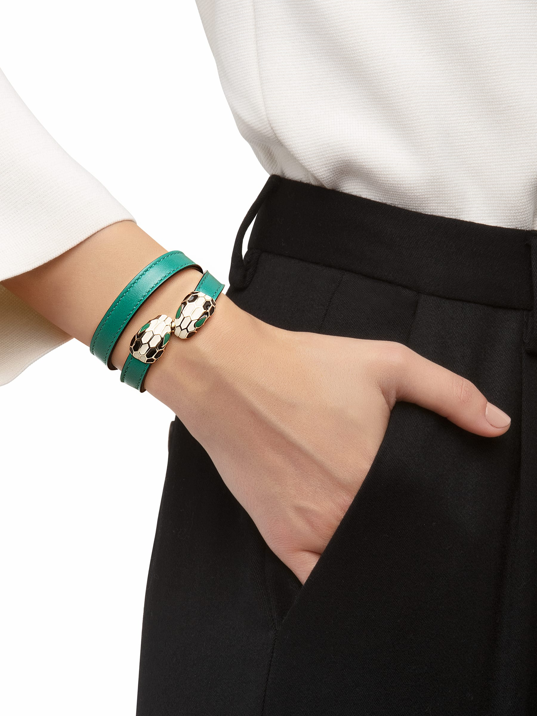 Multi-coiled bracelet in emerald green calf leather. Brass light gold plated iconic contraire Serpenti head closure in black and white enamel with malachite enamel eyes. Also available in other colours. MCSerp-CL-EG image 2