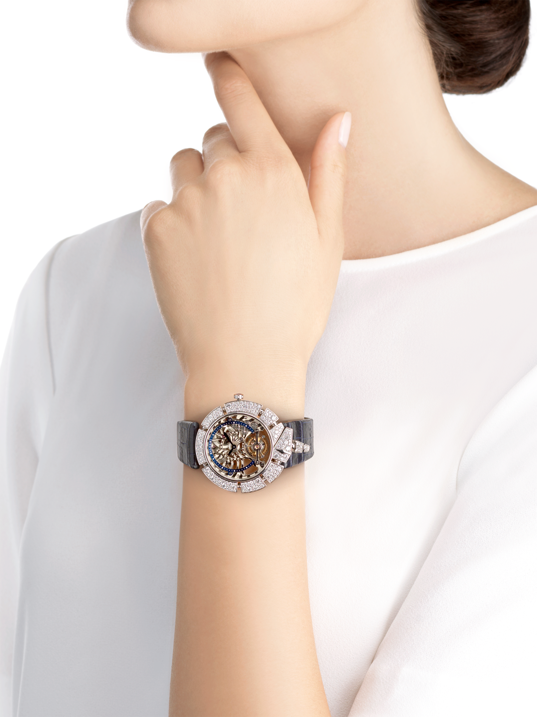 Serpenti Incantati Limited Edition watch with mechanical manufacture skeletonized movement, tourbillon and manual winding. 18 kt white gold case set with brilliant cut diamonds, transparent dial and blue alligator bracelet. 102541 image 4