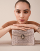 Serpenti Forever crossbody bag in milky opal metallic karung skin. Snakehead closure in light gold plated brass decorated with black and glitter milky opal enamel, and black onyx eyes. 287948 image 5
