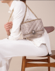 Serpenti Cabochon shoulder bag in soft matelassé milky opal metallic karung skin with graphic motif. Snakehead closure in light gold plated brass decorated with matte black and glitter milky opal enamel, and black onyx eyes. 288619 image 5