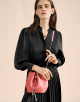 Serpenti Forever bucket in silky coral smooth calf leather and a flamingo quartz inner lining. Hardware in light gold plated brass and snakehead closure in black and white agate enamel, with eyes in black onyx. 288770 image 5