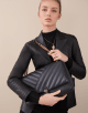 Serpenti Cabochon shoulder bag in soft matelassé black nappa leather with graphic motif and black calf leather. Snakehead closure in rose gold plated brass decorated with matte black and shiny black enamel, and black onyx eyes. 287994 image 4