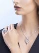 Anel Serpenti em ouro branco 18K cravejado com pavê de diamantes (3,72 ct) e dois olhos de esmeralda (0,26 ct) AN858323 image 5