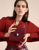 Serpenti Forever crossbody bag in Roman garnet calf leather, with flash amethyst, rosa di francia and white agate calf leather sides. Iconic snakehead closure in light gold plated brass embellished with Roman garnet and rosa di francia enamel and black onyx eyes. 288891 image 6
