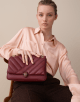 Serpenti Cabochon shoulder bag in soft matelassè roman garnet nappa leather, with a graphic motif, and roman garnet calf leather. Brass light gold plated tempting snake head closure in matte roman garnet and shiny roman garnet enamel, with black onyx eyes. 287985 image 5